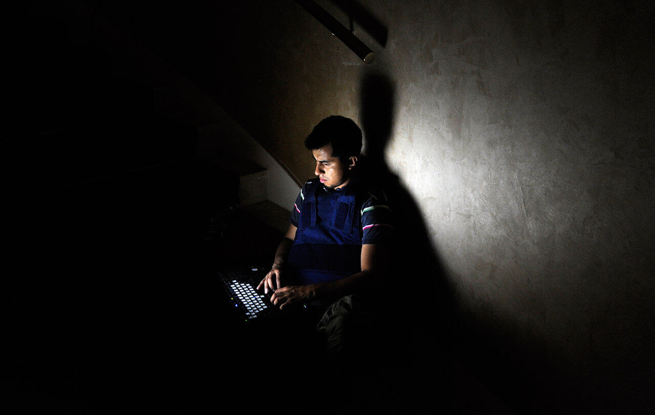 A member of the media works on a staircase at the Rixos hotel during a power cut in Tripoli, Libya, August 22, 2011. (Photo by Paul Hackett/Reuters)